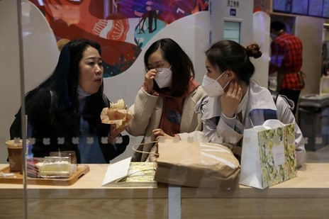 People dine inside a restaurant at a newly opened shopping mall in Beijing, China. (REUTERS)