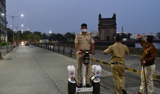 A police personnel patrolling on a segway near Gateway of India before a statewide lockdown to check the spread of Covid-19, at Colaba, in Mumbai. (Bhushan Koyande/ HT Photo)