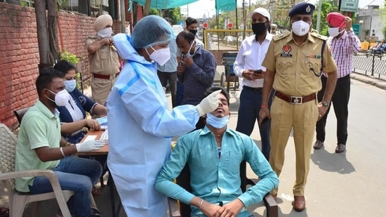 Commuters being tested for Covid-19 at a special camp outside the civil hospital in Ludhiana on Saturday. (Gurpreet Singh/HT)