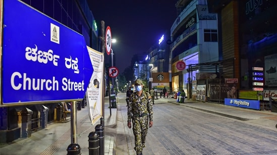 A deserted look of church street after the authorities announced the night curfew amid surge in coronavirus cases in Bengaluru. (PTI Photo)