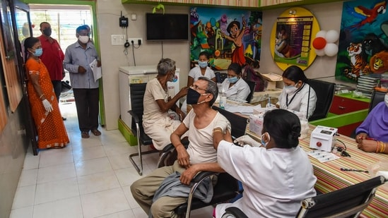 Patna: Beneficiaries receiving the second dose of COVID-19 vaccine at a government dispensary, amid rise in Covid-19 cases across the country, in Patna, Sunday, April 18, 2021. (PTI Photo)(PTI04_18_2021_000013B)(PTI)