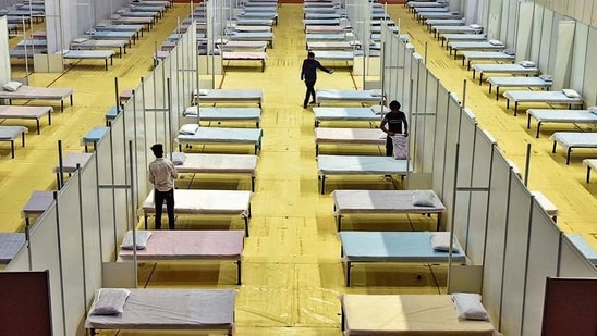 Beds being prepared inside the temporary Covid care centre, at Commonwealth Games Village Sports Complex, in New Delhi, India, on Sunday, April 18, 2021. (Photo by Sanjeev Verma/ Hindustan Times)