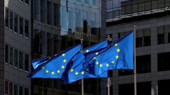 European Union flags flutter outside the European Commission headquarters in Brussels, Belgium.(Reuters)