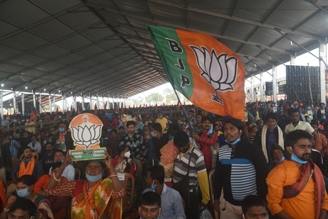 view of the crowd at a public rally by Prime Minister Narendra Modi, with people waving BJP flags, in Haldia, West Bengal in this file picture from February 2021. (Samir Jana / Hindustan Times)