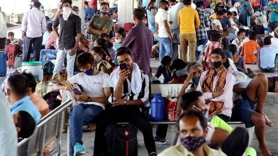 Passengers wait at the station as they arrive to board the train for their hometown amid the surge in Covid-19 cases, at Anand Vihar Railway Station in New Delhi.(ANI)