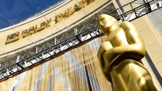 FILE - In this Feb. 24, 2016, file photo, an Oscar statue is pictured underneath the entrance to the Dolby Theatre in Los Angeles. When the Oscars broadcast begins April 25 on ABC, there won't be an audience. The base of the show won't be the Academy Awards' usual home, the Dolby Theatre (though the Dolby will still be involved), but Union Station, the airy, Art Deco-Mission Revival railway hub in downtown Los Angeles. For the producers, the challenges of COVID are an opportunity to, finally, rethink the Oscars. (AP)