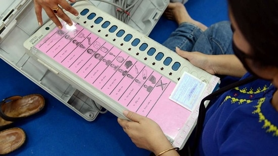 An EVM and its accessories being distributed to polling officials a day before the fourth phase of West Bengal assembly elections in Kolkata on Friday. (ANI)