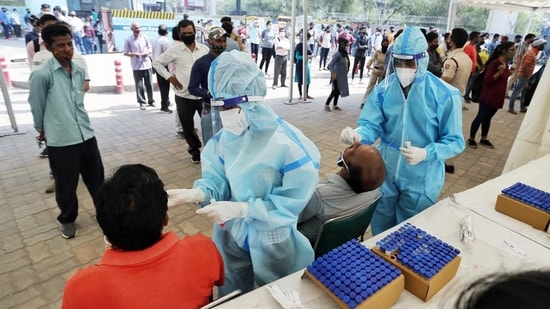 Health workers take swab samples of people for Covid-19 test amid the surge in coronavirus cases.(ANI)
