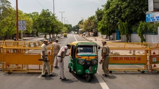 Delhi Police officers stop an autorickshaw at a check point during a weekend lockdown in New Delhi, India, Saturday, April 17, 2021. (AP)