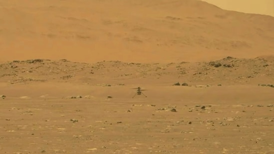In this image from Nasa, Nasa's experimental Mars helicopter Ingenuity lands on the surface of Mars.(AP)