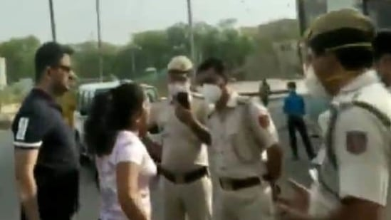 The man has been identified as Pankaj Dutta, a resident of West Patel Nagar. His wife Abha Yadav is seen arguing with the policemen on duty on Sunday.(Videograb)