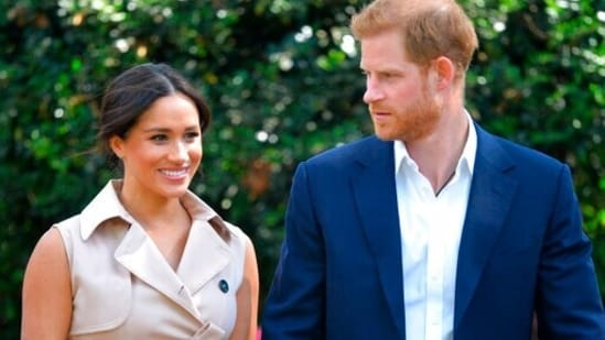 Britain's Prince Harry and Meghan Markle appear at the Creative Industries and Business Reception at the British High Commissioner's residence in Johannesburg. (AP)
