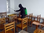 A worker sanitizes the classrooms ahead of the opening of schools after the COVID-19 outbreak, in Srinagar on Saturday. (ANI Photo)