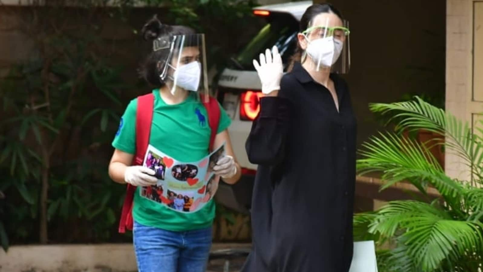 Karisma Kapoor's son, Kiaan, carries a handmade photo card to Kareena Kapoor's home.  Is it for Babita?