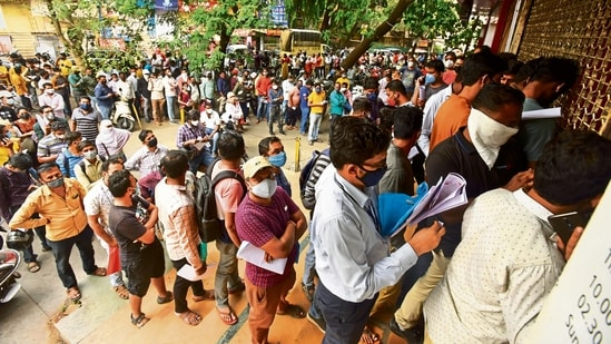 People wait in queues outside the office of the Chemists Association for anti-viral drug Remdesivir, in Pune. (File Photo)