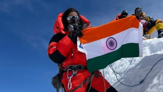 Biocon executive chairperson Kiran Mazumdar-Shaw shared a photo of Priyanka Mohite holding the national flag atop Mount Annapurna's peak. (Photo via @kiranshaw on Twitter)