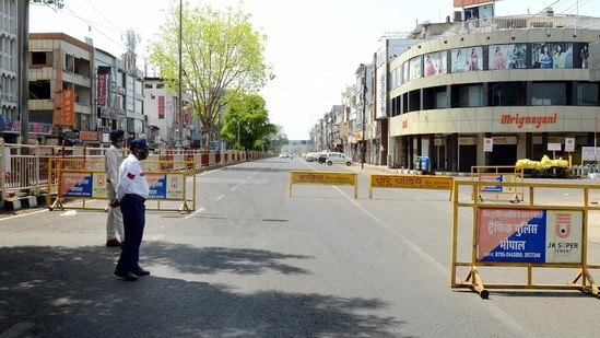 A deserted view of a road during curfew due to a surge in COVID-19 cases, in Bhopal. (ANI / File Photo)