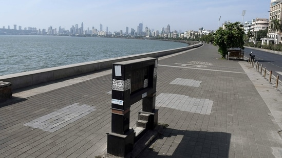 A deserted view of Marine Drive in Mumbai due to curfew-like restrictions which are already in place to curb the spread of the coronavirus.(ANI photo)