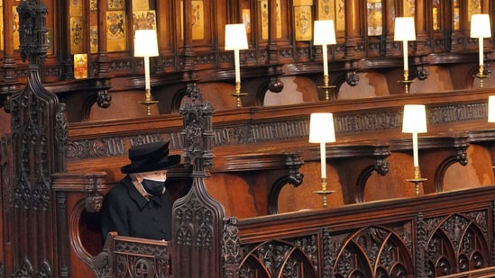 Britain's Queen Elizabeth II sits alone in St. George's Chapel during the funeral of husband Prince Philip at Windsor Castle, Windsor, England, on Saturday, April 17, 2021 (AP).