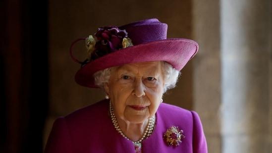 "In this file photo taken on June 8, 2018 Britain's Queen Elizabeth II walks through ""The Queen's Diamond Jubilee Galleries"" at Westminster Abbey in London.(AFP)"