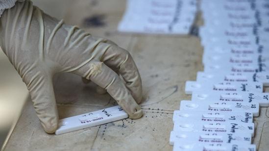 A medic sorts swab samples for Covid-19 testing at a hospital in Mumbai on Monday. (PTI Photo )