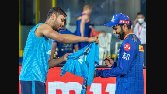 IPL 2021: The image shows Rohit Sharma signing Avesh Khan's jersey.(Twitter/@DelhiCapitals)