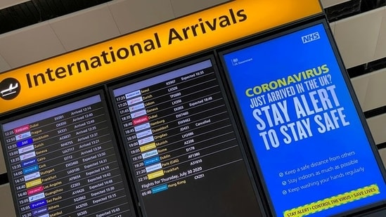 A public health campaign message is displayed on an arrivals information board at Heathrow Airport in London, Britain. (REUTERS)