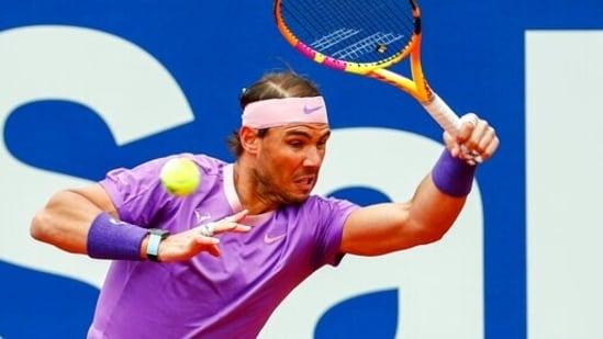 Rafael Nadal returns the ball to Ilya Ivashka of Belarus during the Godo tennis tournament in Barcelona,(AP)