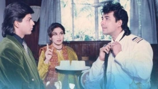 Madhuri Dixit with her co-actors in the movie, Shah Rukh Khan and Deepak Tijori.