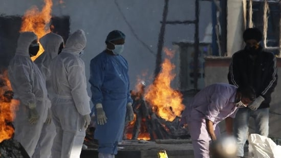 A day after India saw the world's biggest one-day jump in Covid-19 cases ever, the country again broke all records as 332,394 new infections and 2,255 deaths were reported on Thursday, both new single-day records.(AP Photo)