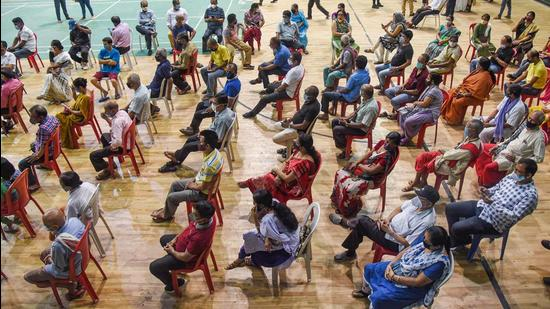 Beneficiaries wait at a health centre to receive the dose of Covid-19 vaccine, in Guwahati on Thursday, April 22. (PTI)