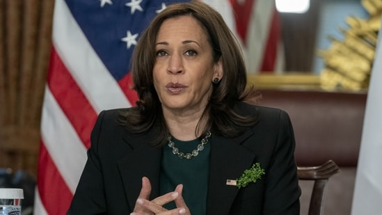 """""""My mother was a scientist and raised me to appreciate the power of science. On this #EarthDay, I am proud that science is back in the White House,"""" Harris wrote in a tweet on Thursday.(Bloomberg)"""