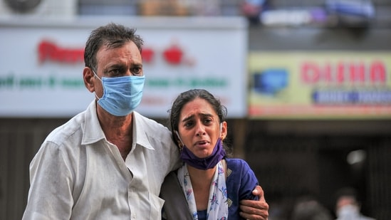 Family members react after a fire at a Covid-19 hospital where at least 13 people died, in Virar, Friday, April 23, 2021.(PTI)
