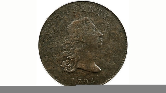 This undated photo provided by Heritage Auctions shows the front of a piece of copper that was struck by the US Mint in Philadelphia in 1794 and was a prototype for the fledgling nation's money.(AP)
