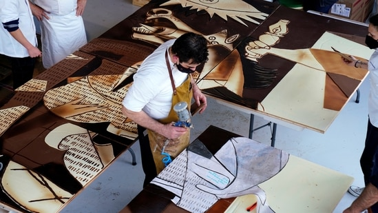 Cooks from Euskal Gozogileak (Basque confectioners) create a full-sized reproduction of Picasso's Guernica made with chocolate.(REUTERS)