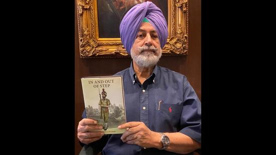 Former Punjab director general of police GS Aujla with his book book, In And Out Of Step. (HT Photo)