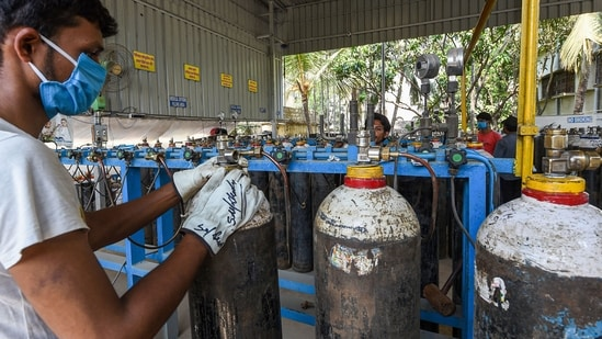 Workers refill cylinders with medical oxygen for supply for Covid-19 patients, amid a surge in coronavirus cases in Kolkata on Saturday.(PTI Photo)