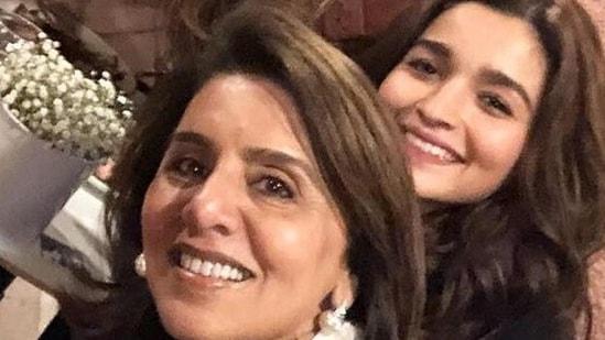 Neetu Kapoor and Alia Bhatt pose together.