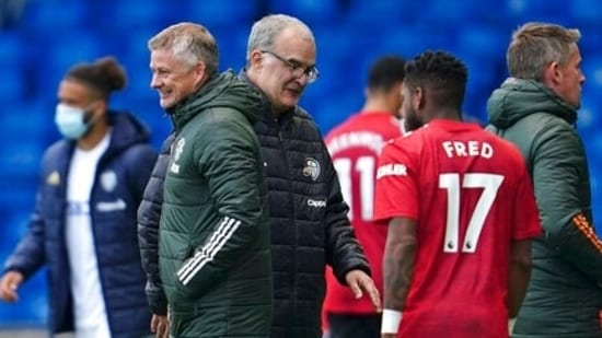 Leeds United's head coach Marcelo Bielsa, center, and Manchester United's manager Ole Gunnar Solskjaer greet each other.(AP)