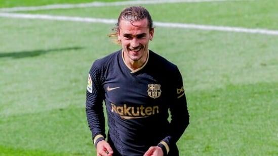Barcelona's Antoine Griezmann celebrates after scoring his side's second goal.(AP)