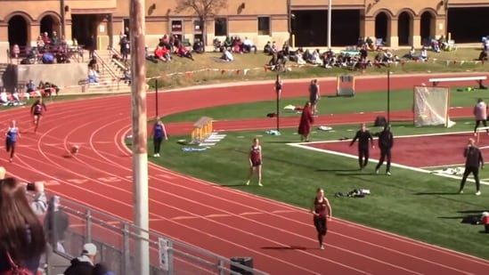 The video of the dog crashing a relay race has gone all kinds of viral.(YouTube/@MileSplit)