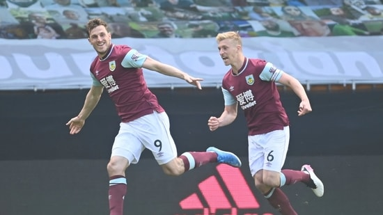 Burnley's Chris Wood, left, celebrates after scoring his side's third goal during the English Premier League soccer match between Wolves and Burnley.(AP)