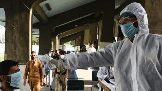 A man undergoes thermal screening at a special Covid-19 helpdesk.(Vipin Kumar/HT PHOTO)