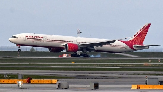 Air India flight 185 arrives from New Delhi, narrowly beating the cut-off after Canada's government temporarily barred passenger flights from India and Pakistan for 30 days, at Vancouver International Airport in Richmond, British Columbia, Canada(REUTERS)