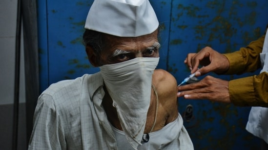 A medic administers Covid-19 vaccine to a senior citizen at TMC's C.R. Wadia Hospital, in Thane, Mumbai, India, on Monday, April 26, 2021. ( Praful Gangurde / HT Photo )