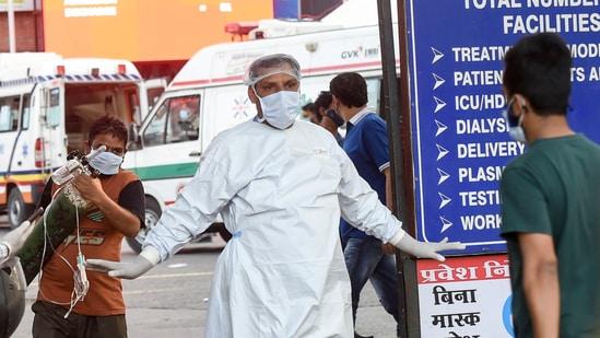 A medical professional gestures outside LNJP Hospital, in New Delhi.(Manvender Vashist / PTI)