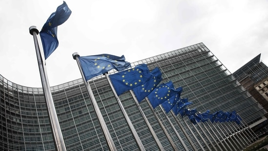 European Union flags fly outside the headquarters of the European Commission in Brussels.(AFP)
