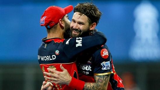 RCB's Kane Richardson with Virat Kohli.(PTI)