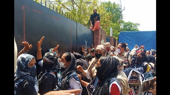 Members of the Punjab Anganwadi Mulazam Union during a protest in front of the Sangrur deputy commissioner's office on Monday.