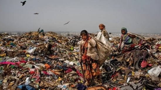 Trash pickers look for recyclable waste at the Bhalswa landfill on the outskirts of New Delhi, India.(AP)